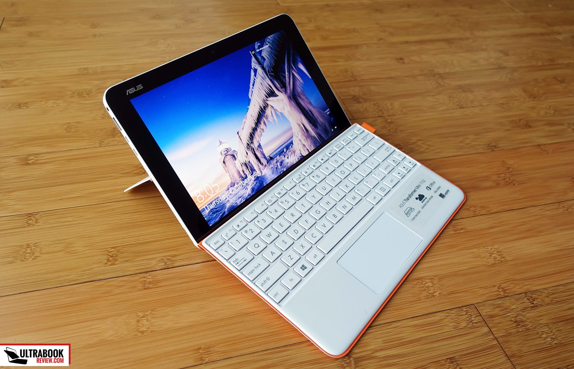 This is the Asus Transformer Mini T102HA in white, with the included orange/white keyboard folio